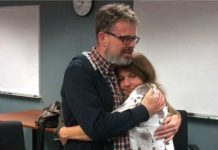 kevin-and-julie-garratt-embrace-at-vancouver-airport-after-his-release