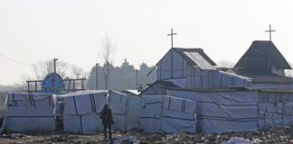 The church in the dismantled area of the Jungle camp for migrants.