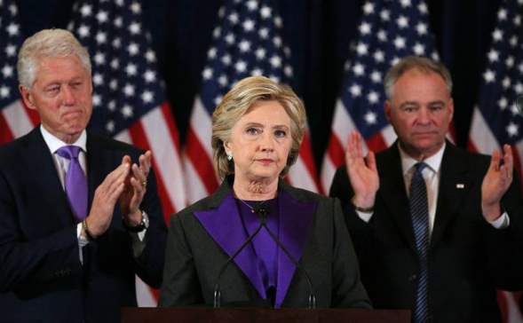 Hillary Clinton, accompanied by her husband former U.S. President Bill Clinton (L) and running mate Senator Tim Kaine, addresses her staff and supporters about the results of the U.S. election at a hotel in New York, November 9, 2016.