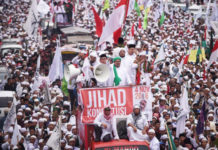 Member of hardline Muslim groups attend a protest against Jakarta's incumbent governor Basuki Tjahaja Purnama.