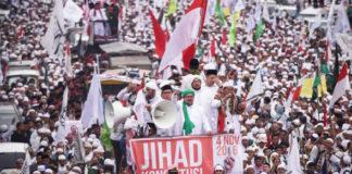 Member of hardline Muslim groups attend a protest against Jakarta's incumbent governor Basuki Tjahaja Purnama.