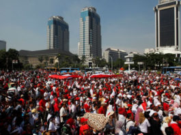 People take part in a rally against what they see as growing racial and religious intolerance in the world's largest Muslim-majority country, in Jakarta, Indonesia, November 19, 2016.