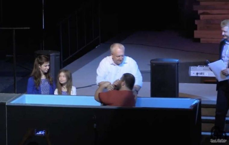 Pastor Robert Hogan of the Spring First Church in Houston, Texas baptises Jacob McKelvy, founder of the Greater Church of Lucifer as he recieves Jesus Christ