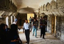 Muslim neighbors in Iraq repairing destroyed church