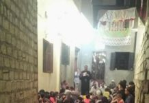 The Copts congregate in an alleyway to pray.