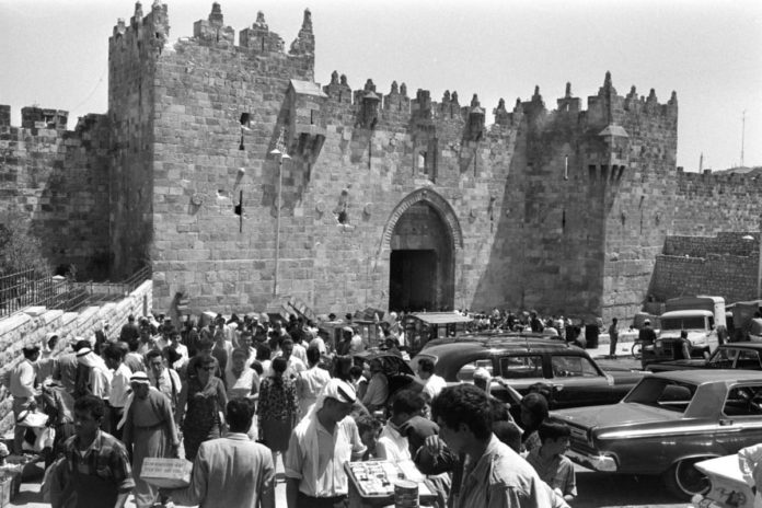 People walk near Damascus Gate leading into Jerusalem's Old City taken July 14, 1967. On June 1967 Jews were allowed to enter the eastern half of Jerusalem for the first time in 19 years. Fritz Cohen/Courtesy of Government Press Office/Handout via Reuters