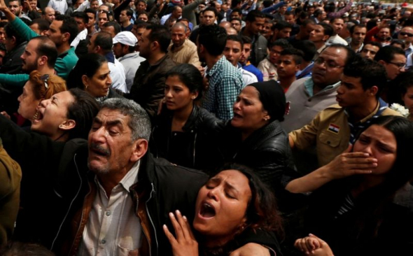 Relatives mourn victims of the Palm Sunday bombings during a funeral at the Monastery of Saint Mina in Alexandria, Egypt, April 10, 2017.