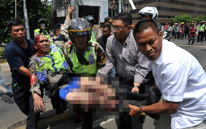 Family of suicide bombers attacks 3 churches in Indonesia