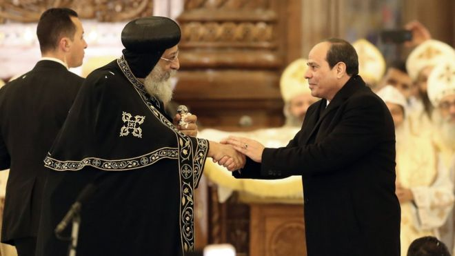 Pope Tawadros II (L) led a midnight mass attended by President Abdel Fattah al-Sisi (R)