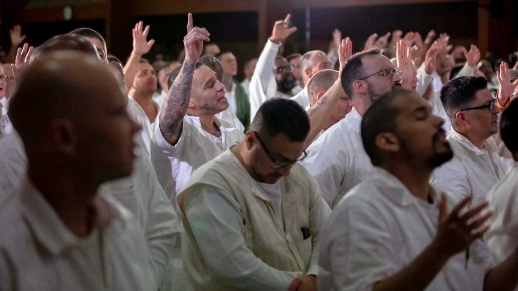 Inmates at the Coffield Unit, a maximum security prison in Anderson County, Texas, worship during a church service. They are part of the newest campus for Gateway Church of Dallas, Texas. (Gateway Church)