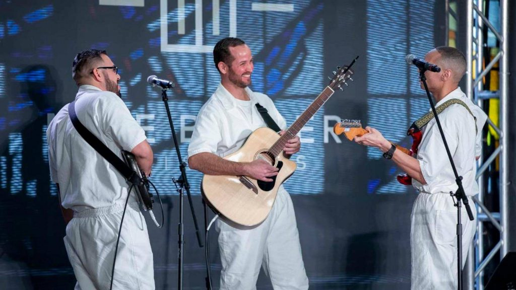 Three inmates serve on the worship team during a service at Gateway Church's newest campus, Coffield Unit, which is also the largest prison in Texas. (Gateway Church Photography)