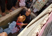 Bishop William Harris baptizes the Village Witch