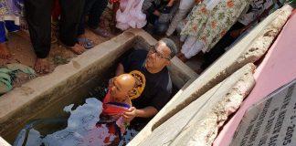 Bishop William Harris baptizes the Village Witch