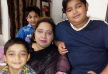 Pakistani Christian mother of three, Saima Iqbal, with her children
