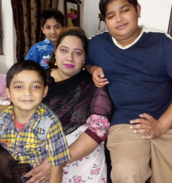 Pakistani Christian mother of three, Saima Iqbal, with her children