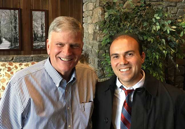 Pastor Saeed Abedini pictured with the Rev. Franklin Graham