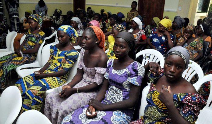 Chibok school girls recently freed from Boko Haram captivity are seen in Abuja, Nigeria, Sunday, May 7, 2017. (AP Photo/ Olamikan Gbemiga)