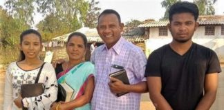 Vijay Kumar Pusuru with family members, whose home in Odisha state, India, was demolished along with his school.