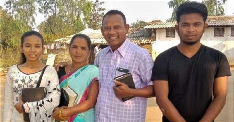 Vijay Kumar Pusuru with family members, whose home in Odisha state, India, was demolished along with his school.