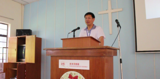 Pastor John Cao speaking in this undated photo before his imprisonment in China based on charges of illegal border crossings.
