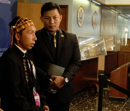 Pastor Langjaw Gam Seng (L) speaks with reporters during the U.S. State Department's Ministerial to Advance Religious Freedom at the Harry S. Truman Building in Washington, D.C., on July 17, 2019.