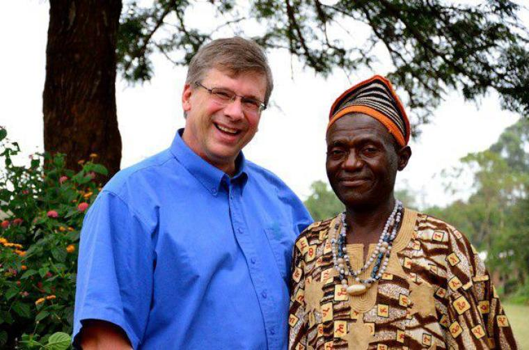 Bible translator Angus Fung (R) poses for a photo with Tearfund Canada President Wayne Johnson (L) in Wum, Cameroon.