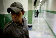 A prison guard stands along a corridor in Tehran's Evin prison.