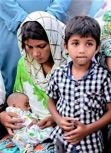 Wife of slain Amir Masih with 2-week-old and 7-year-old sons.