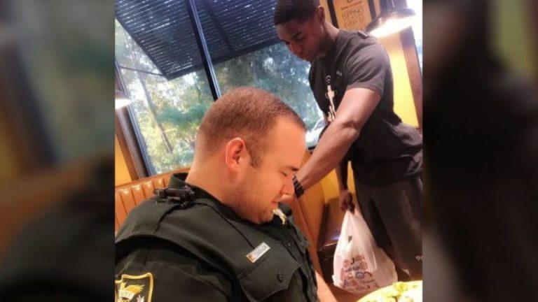 Young Man Praying Over Florida Police Deputy (Photo)