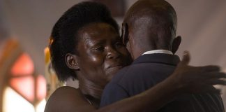 A Genocide survivor, Anne-Marie Uwimana, hugs Celestin Habinshuti, a former Genocide convict who brutally killed two of her children during the 1994 Genocide against the Tutsi.