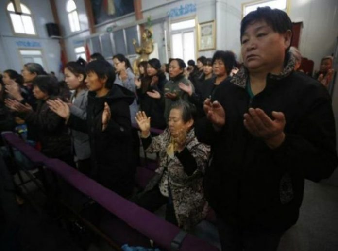 Chinese Christians pray at an underground church in Tianjin