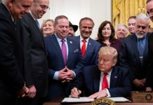 President Donald J. Trump signs H.R. 2476 the Securing American Nonprofit Organizations Against Terrorism Act of 2019, following his remarks at the Nation's Mayors on Transforming America's Communities meeting Friday, Jan. 24, 2020, in the East Room of the White House. | Official White House Photo/Tia Dufour