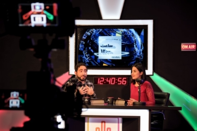 "SAT-7 PARS ""Signal"" presenters Reza Jafari (L) and Niloufar Raisi (R) 