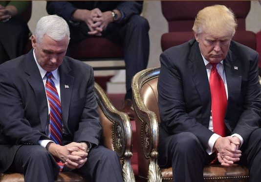 United States President Donald J. Trump with Vice President Mike Pence In Prayer