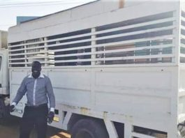 The Rev. Philemon Hassan Kharata with Baptist church truck confiscated in 2012.