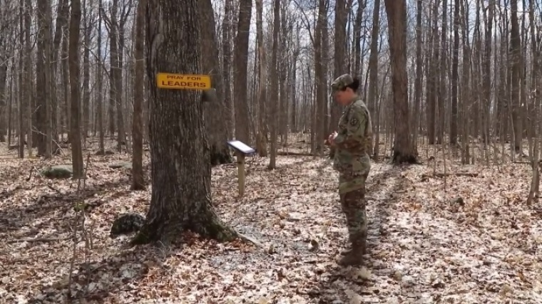 U.S. Army Chaplain Amy Smith prays while walking on the Spiritual Fitness Trail at Fort Drum in New York.