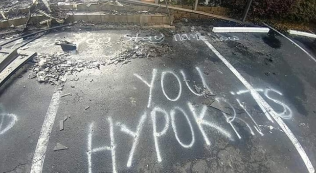 "The graffiti in the parking lot reads: ""Bet you stay home now you hypokrits"