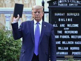 Trump visits White House Church vandalized by protesters, holding a bible in his hand