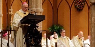 Archbishop Carlo Maria Viganò, Apostolic Nuncio of the United States, reads the Apostolic Mandate during the Installation Mass of Archbishop Blase Cupich at Holy Name Cathedral, November 18, 2014, in Chicago.