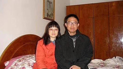 Liu Xianbin (right) with his wife, Chen Mingxian, at home on June 27, 2020.