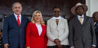Ugandan President Yoweri Museveni (R) and Uganda's First Lady Janet Museveni (2nd R) pose for photo with Israeli Prime Minister… Ugandan President Yoweri Museveni, right, and Uganda's First Lady Janet Museveni, 2nd from right, pose for a photo with Israeli Prime Minister Benjamin Netanyahu, left, and his wife Sara Netanyahu, at the State House in Entebbe, Uganda on Feb. 3, 2020.
