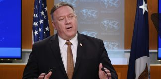 U.S. Secretary of State Mike Pompeo speaks during a news conference at the State Department on Wednesday, March 25, 2020, in Washington.