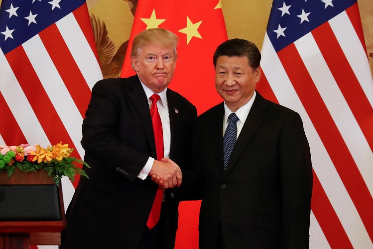 U.S. President Donald Trump and China's President Xi Jinping shake hands after making joint statements at the Great Hall of the People in Beijing, China, November 9, 2017. REUTERS/Damir Sagolj
