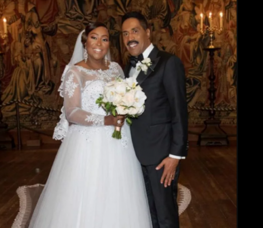 Dr. Cindy Trimm-Tomlinson and her husband Russell Tomlinson on their wedding day in October, 2018.