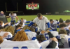 Football Coach Leads Team in Prayer