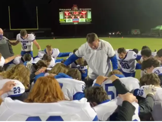 Football Coach Leads Team in Prayer