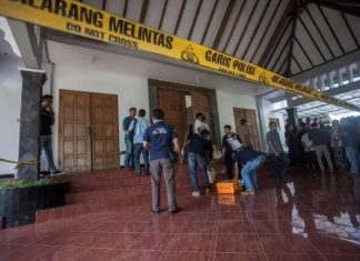 Police are seen outside the Lidwina Catholic Church after a knife-wielding attacker wounded four church-goers in Sleman, Yogyakarta, Indonesia, on February 11, 2018